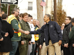 Image: U.S. President Obama shakes hands during visit to a hurricane battered Staten Island neighborhood in New York