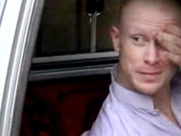 Image: Bowe Bergdahl sits in a vehicle guarded by the Taliban