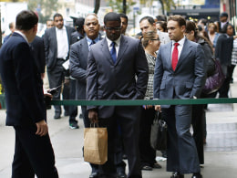 Image: Job seekers stand in line to meet prospective employers at a career fair in New York City in this file photo