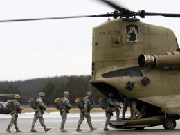 Image: Soldiers of 173rd Airborne Brigade Combat Teams enter CH-47 'Chinook' helicopter during exercise at US military base in Grafenwoehr
