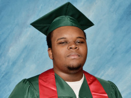 Image: Image: Michael Brown poses for a photo in his cap and gown taken in March 2014