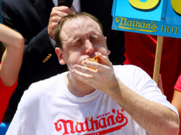Image: Top Speed Eaters Compete In Nathan's Hot Dog Eating Contest