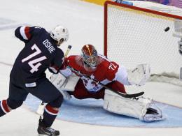 Image: Team USA's Oshie scores on the team's sixth shootout attempt against Russia's goalie Bobrovski during their men's preliminary round ice hockey game at the Sochi 2014 Winter Olympic Games