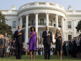 Image: The Obamas and Bidens pause for silence on the September 11th anniversary at the White House in Washington
