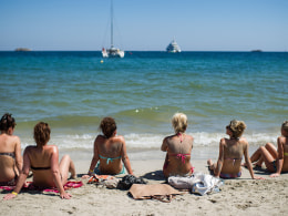 European Tourists Flock To Ibiza For Their Summer Holidays