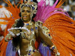 Image: Beija-Flor samba school's Drum Queen Rayssa Oliveira performs during the carnival parade at the Sambadrome in Rio de Janeiro