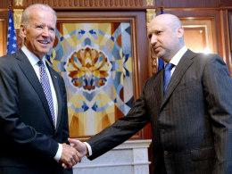 Image: Olexander Turchynov, speaker of the parliament and interim Ukrainian president, welcomes US Vice President Joe Biden in Kiev