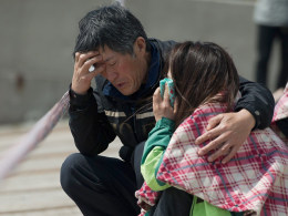 Image: Relatives of a passenger on board the capsized South Korean ferry Sewol