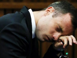 Image: Oscar Pistorius reacts during his trial for the murder of his girlfriend Reeva Steenkamp