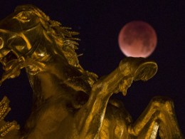 Image: The Moon, appearing next to a statue on the Alexander III bridge in Paris