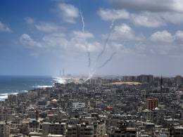 Image: Smokes from rockets fired from near Gaza City is seen after  being launched toward Israel