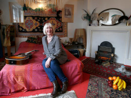 Image: Former girlfriend of Jimi Hendrix, Kathy Etchingham, sits on a bed in the restored bedroom of the home where they lived in 1968-69  London