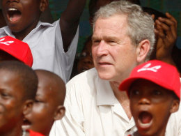 U.S. President Bush watches a T-ball game alongside members of the Little Saints in Accra