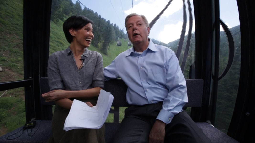 Alex wagner and lindsey graham take a gondola ride through aspen