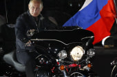 Putin rocks leather at motorcycle rally