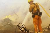 Firefighters hope wet weather will weaken...
