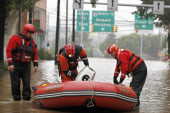Deadly floods force 100,000 to evacuate