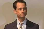 Weiner heckled at press conference to...