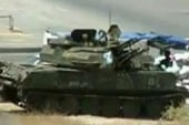 Violence grows as Syrian troops take...