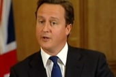 Ex-Cameron aide arrested in hacking scandal