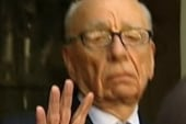 Murdoch turns from defiant to contrite