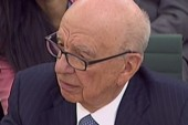 Murdoch denies blame in hacking scandal