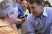 Rick Perry hounded by his own written words