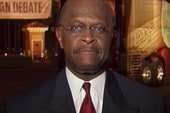 Herman Cain talks to Ed Schultz after the...