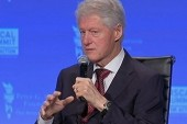 Clinton takes aim at Romney's budget plan