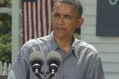Obama blasts Romney on bus tour