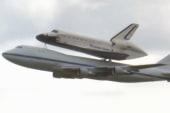 Space shuttle Endeavour piggybacks on...