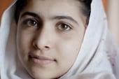 Young activist Malala Yousufzai clings to...