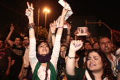 Iranians pack streets, celebrate new...
