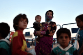 Kobani refugees report ISIS beheadings,...