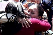 Separated families embrace at border