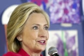 Clinton switches gears to fight for...