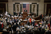 Representatives chant as House returns for...