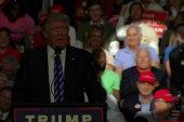 Disgraced FL congressman sits behind Trump