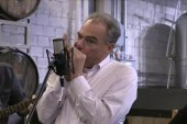 Tim Kaine plays harmonica at campaign stop