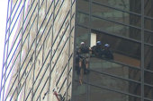 Watch police snatch man climbing Trump Tower