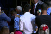 Pence comforts boy with terminally ill father