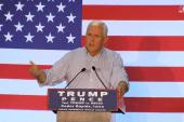 Pence calls for shutdown of Clinton...