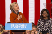 Clinton praises Michelle Obama