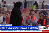 Tens of thousands flee violence in Mosul