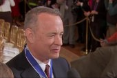 Tom Hanks reacts to being awarded Medal of...