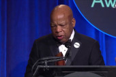 John Lewis tearfully accepts book award