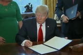 Trump rolls back financial regulations