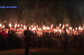 Torch-Wielding Protesters Gather to Oppose...