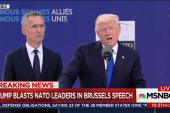 Stone-faced world leaders listen as Trump...