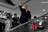 Trump goes from escalator to under...